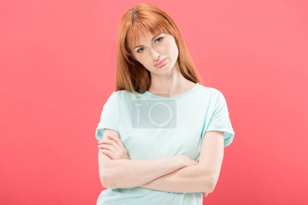Photo for Front view of pensive redhead young woman in t-shirt standing with crossed arms isolated on pink - Royalty Free Image