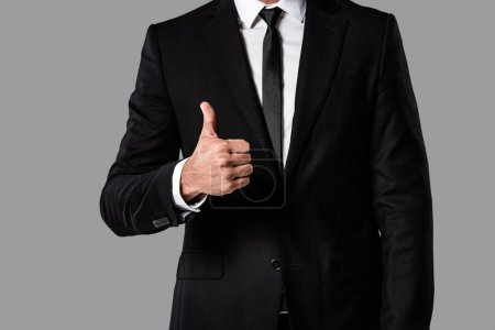 Photo for Cropped view of businessman in black suit showing thumb up isolated on grey - Royalty Free Image