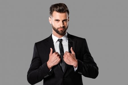 Photo for Handsome stylish businessman in black suit isolated on grey - Royalty Free Image