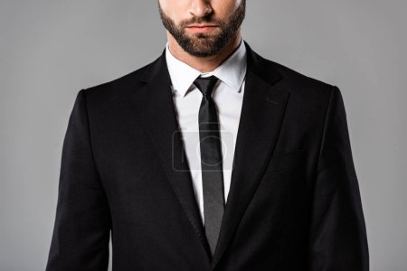 Photo for Cropped view of serious bearded businessman in black suit isolated on grey - Royalty Free Image