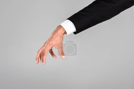 Photo for Partial view of businessman hand gesturing isolated on grey - Royalty Free Image