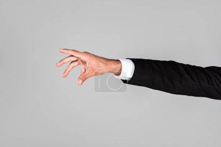 cropped view of businessman hand gesturing isolated on grey