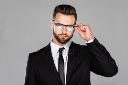 Photo for Handsome businessman in black suit and glasses isolated on grey - Royalty Free Image
