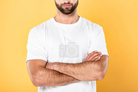 Photo for Cropped view of man in white t-shirt with crossed arms isolated on yellow - Royalty Free Image