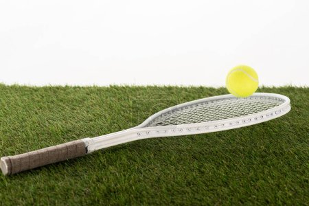 Photo pour Tennis racket and ball on green grass isolated on white, sport paris concept - image libre de droit