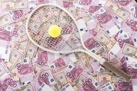 top view of tennis racket and ball on euro and dollar banknotes, sports betting concept