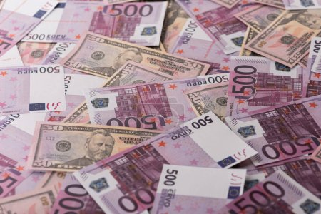 background of spread euro and dollar banknotes, sports betting concept