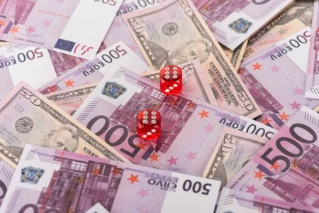 dice on euro and dollar banknotes, sports betting concept