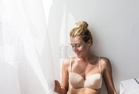 Portrait of beautiful Caucasian woman wearing lingerie.