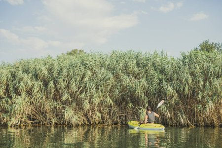 Photo for Handsome Caucasian man kayaker paddling on the river. - Royalty Free Image