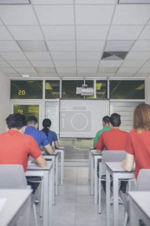 High school students doing an exam at classroom.