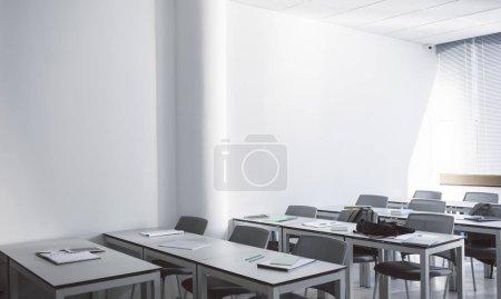 Furniture in empty high school classroom.