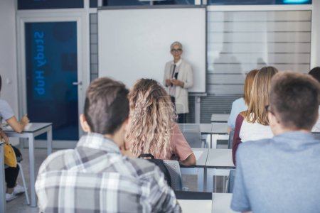 Photo for Group of a high school students having a class at modern classroom. - Royalty Free Image