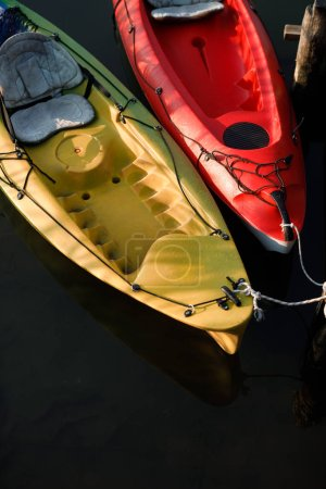 Two tied kayaks floating in the water.
