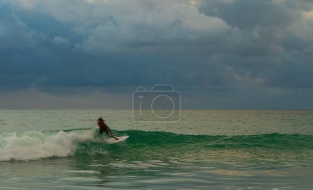 Photo for Surfer riding the waves. Bali, surfing paradise - Royalty Free Image