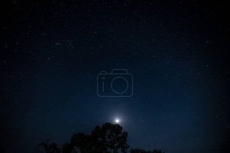 Photo for Night landscape beautiful milky way with moon. Milky way raise over the hill - Royalty Free Image