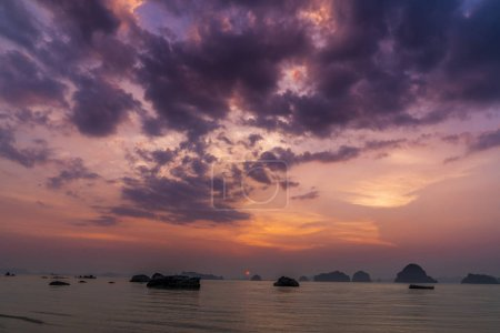 Photo for Amazing sunset in Andaman sea with many islands. Colorful cloudy twilight seascape with red sun - Royalty Free Image