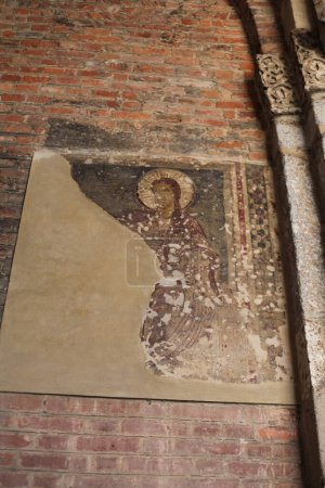 Photo for Old brick wall with damaged religious icon - Royalty Free Image