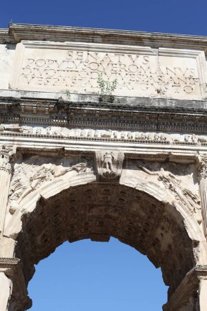 Photo for The Arch of Constantine is a triumphal arch in Rome, situated between the Colosseum and the Palatine Hill. - Royalty Free Image