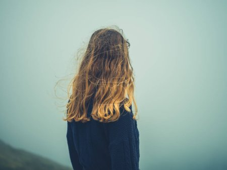 Photo for A young woman is standing in the mist - Royalty Free Image