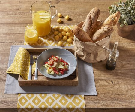 Photo for Healty foods at the breakfast with orange juice and light bread on the wooden table - Royalty Free Image