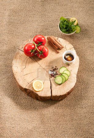 Photo for Wooden plate with vegetables on background,close up - Royalty Free Image