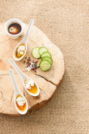 Photo for Wooden plate with cucumber on background,close up - Royalty Free Image