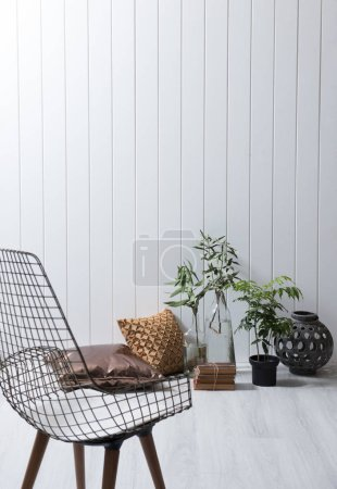 Photo for White wall still life furniture chair, poillow lamp and vase of plant. - Royalty Free Image