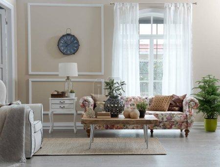 Foto de Salón flores patrón sofá y decoración, diseño de interiores - Imagen libre de derechos