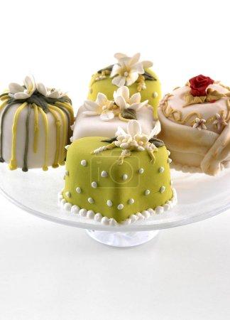 Photo for Tasty mini cakes on background,close up - Royalty Free Image