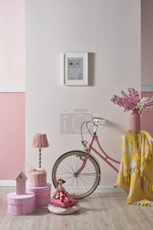 Photo for Pink baby and kid room style with bike chair and cabinet decoration. - Royalty Free Image
