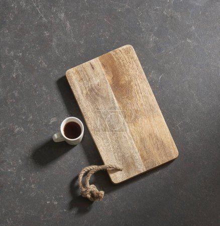 Photo for Black background cutting board with  coffee - Royalty Free Image