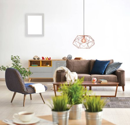 Photo for Modern living room concept with close up table vase of plant and sofa armchair lamp background style. - Royalty Free Image