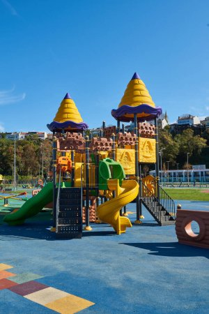 Photo for Yellow and blue slides swing in the modern new style park. - Royalty Free Image