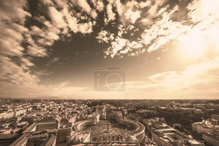 Famous Saint Peters Square in Vatican and aerial view of Rome, Italy with buildings.