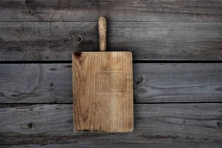 Photo for Wooden cutting board on dark background - Royalty Free Image