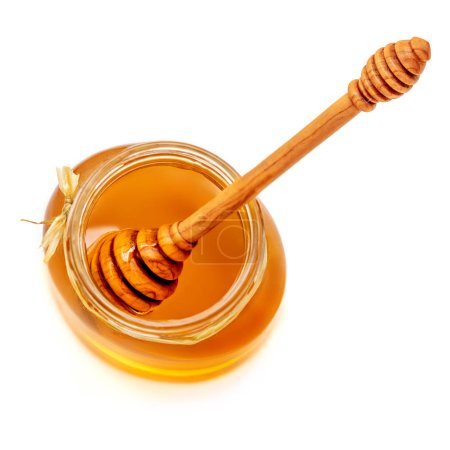 honey dipper and honey in jar isolated on white background. Sweet Natural bee Honey. Top view