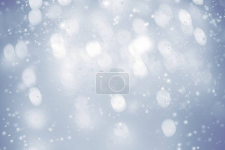 Beautiful Christmas  background with snowflakes and   glittering bokeh stars. Abstract  Glowing blurred lights