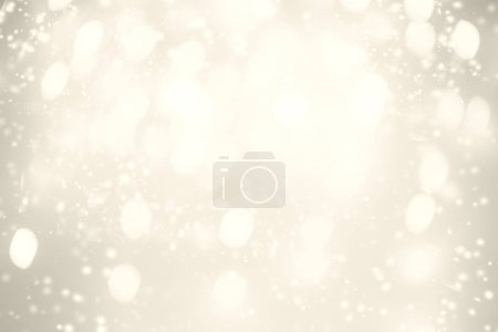 Gold Festive Christmas background. Abstract twinkled bright background with bokeh defocused golden lights and stars
