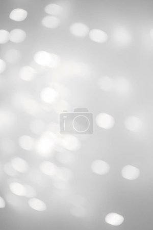 Bokeh  Silver Christmas Background with white  lights for Holiday Poster, Banner, Ad, Card or invitation