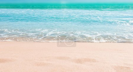Photo for Soft wave of blue ocean on sandy beach. Summer Background. Copyspace - Royalty Free Image