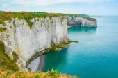The alabaster cliffs of Etretat in Normandy, France.