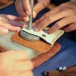 Craftsman pinching button on leather bag. handmade...