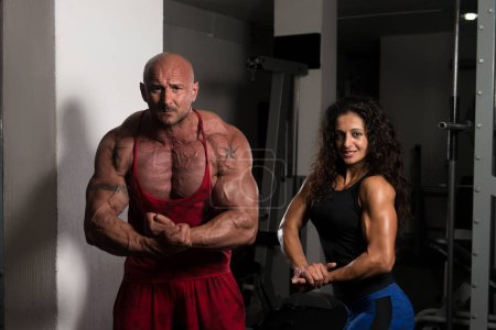 Portrait Of A Sexy Couple In The Gym With Exercise...