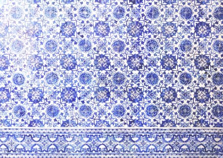 Mosaic tiles, Portugal Azulejo Classic and Traditional. Blue Patterned wall, medieval ceramics tiles, heritage. Painted panel with a round geometric pattern. Mauritanian Wall