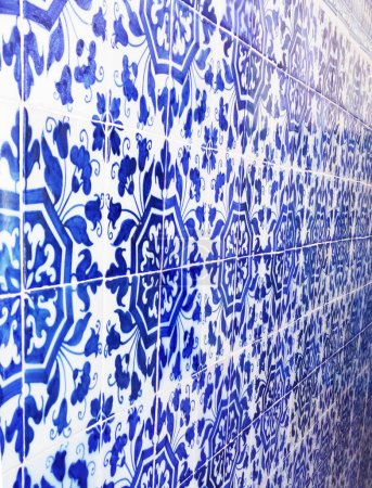 Mosaic tiles, Portugal Azulejo Classic and Traditional. Blue Patterned wall, medieval ceramics tiles, heritage. Painted panel with a round geometric pattern.  Lisbon city