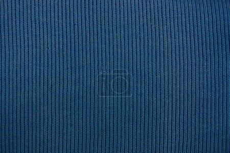 Foto de Fondo de tela azul sobre una pieza de ropa - Imagen libre de derechos