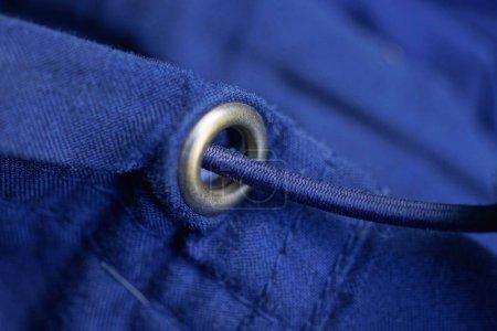Foto de Blue fabric background of the jacket with a seam and long lace - Imagen libre de derechos