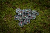 A bunch of broken compasses lying on ground in the forest. Hiking. Adventure.