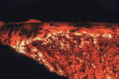 Photo for Derweze or Darvaza, aka the Door to Hell is a huge crater of burning natural gas in the Kara-kum desert in Turkmenistan. - Royalty Free Image